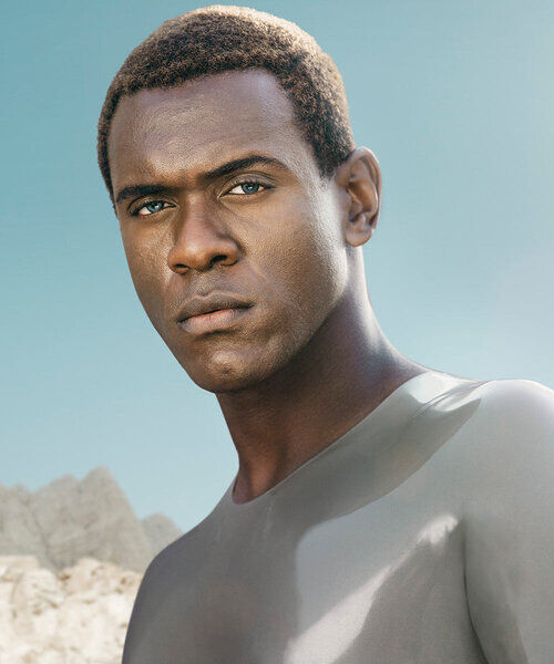 An image of Father, a black man with short curly hair.